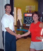 Fitness club owner shaking hands with a Fitness Life Marketing membership promotion representative.